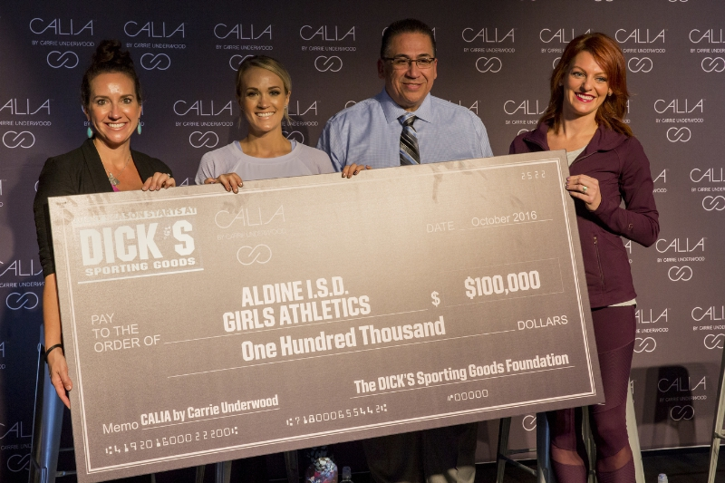 CALIA by Carrie Underwood in partnership with The DICK'S Sporting Goods Foundation's Sports Matter program surprises unsuspecting athletes and coaches of the Aldine Independent School District with a $100,000 check donation at the DICK'S Sporting Goods Grand Opening Celebration at Baybrook Mall in Friendswood, TX on October 21, 2016. (Photo by Scott Dalton/Invision for DICK'S Sporting Goods/AP Images) (PRNewsFoto/DICK'S Sporting Goods)