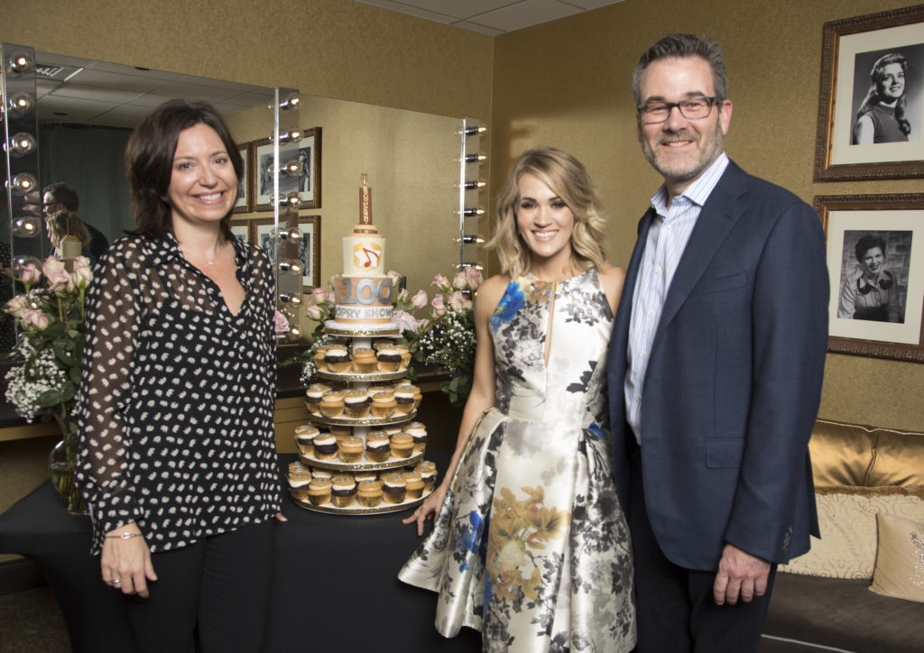 Sally Williams/General Manager, Grand Ole Opry / Sr. Vice President, Programming & Artist Relations, Opry Entertainment, Carrie, and Steve Buchanan/ President/ Opry Entertainment Grou, with specially-decorated cake from IveyCake