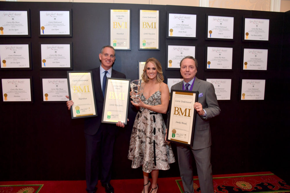 Mike O'Neill and Jody Williams, Vice President, Writer/Publisher Relations, BMI Nashville, present Carrie Underwood and Carrie-Okie Music with recent BMI Songwriting Awards and Million-Air Certifications